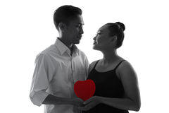 Couple with red heart, isolated silhouette royalty free stock images