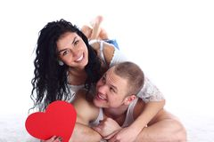 Couple with red heart lie on the floor Stock Image