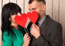 Couple with red heart Stock Images