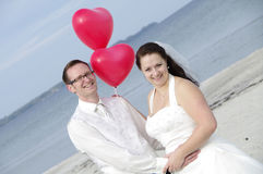 Couple with red heart-shaped balloons  Stock Photo