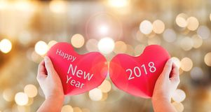 Couple Red Heart With Text Happy New Year 2018 On Gold Bokeh Background Stock Image