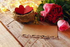 Couple of red hearts in the nest on wooden table Stock Photography