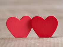 Couple of red hearts on wood floor. Love and Valentine concept. Happy Valentine's day Stock Photo