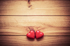 A couple of red little hearts on wood. Vintage concept of love, Valentine's Day Stock Images