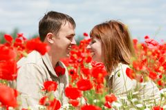 Couple on red poppies field Royalty Free Stock Image