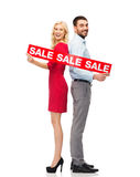 Couple with red sale sign standing to back Royalty Free Stock Photos