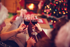 Couple with red wine, against xmas tree and fireplace Royalty Free Stock Image