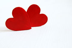 Couple of red wooden hearts Stock Photography