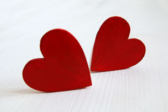 Couple of red wooden hearts Stock Image