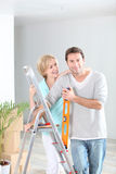 Couple redecorating home Stock Images