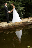 Couple Reflect. A bride and groom on their wedding day Stock Image