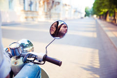 Couple reflected in the scooter mirror Stock Image