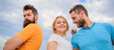 Couple and rejected partner. How get over breakup for guys. Ruined relationships. How deal with offended feelings. Girl. Stand between two men. Psychology of royalty free stock image