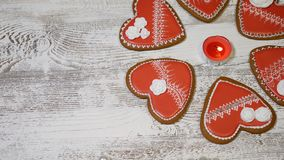 Couple relations concept. St. Valentine`s Day background. Heart shaped ginger biscuits,burning tea candle on wooden. Couple relations concept. St. Valentine s stock video footage