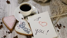 Couple relations. St Valentine`s Day concept. A cup of coffee and ginger biscuit with knitting needle and yarn on wooden. Couple relations. St Valentine s Day stock video