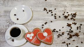 Couple relations. St Valentine`s Day concept. Top view of two cups of coffee. One is held by female hand. Decorated with. Couple relations. St Valentine s Day stock video footage