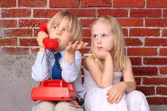 Couple. Relationship and communication. Girl and boy with the phone. Relationship and communication. Humor Stock Photo
