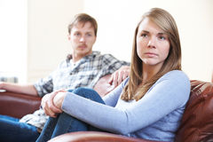 Couple With Relationship Difficulties Sitting On Sofa Stock Photo
