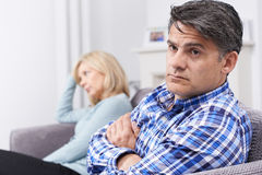 Couple With Relationship Difficulties Sitting On Sofa. Unhappy Couple With Relationship Difficulties Sitting On Sofa royalty free stock photography