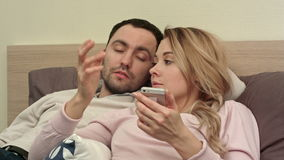 Couple relationships problem, conflict sitting on bed because of the jealous stock video footage