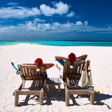 Couple relax on a beach at christmas. Couple relax on a tropical beach at christmas Stock Images
