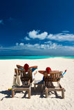 Couple relax on a beach at christmas. Couple relax on a tropical beach at christmas Royalty Free Stock Images