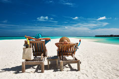 Couple relax on a beach at Maldives Stock Image