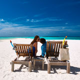 Couple relax on a beach at Maldives Stock Photo