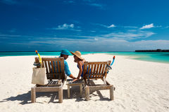 Couple relax on a beach at Maldives Royalty Free Stock Photography