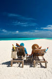 Couple relax on a beach at Maldives Stock Photos