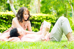 Couple relax in garden Royalty Free Stock Photography