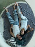 Couple relax and have fun in bed Stock Image
