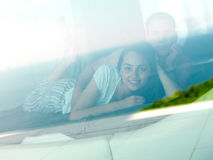 Couple relax and have fun in bed Stock Images