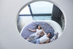 Couple relax and have fun in bed Royalty Free Stock Image