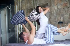 Couple relax and have fun in bed Stock Photography