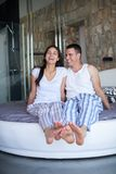 Couple relax and have fun in bed Stock Photos