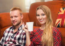 Couple relax at home with cup of coffee Royalty Free Stock Photography
