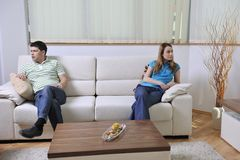 Couple relax at home on sofa in living room Stock Photo