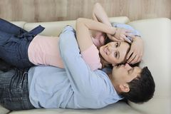 Couple relax at home on sofa in living room Royalty Free Stock Images