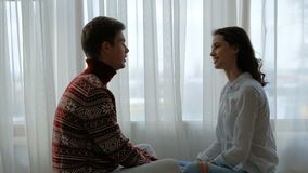 Couple relax leisure communication talk hold hand. Couple relaxed leisure. communication and conversation concept. young man and woman talking sitting at home stock video