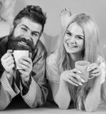 Couple relax in morning with coffee. Family tradition concept. Couple in love drink coffee in bed. Man and woman in. Couple relax in morning with coffee. Family royalty free stock image