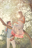 Couple relax under the tree. Fine art style. Olive garden. Royalty Free Stock Photos