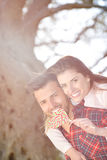 Couple relax under the tree. Fine art style. Olive garden. Stock Photo