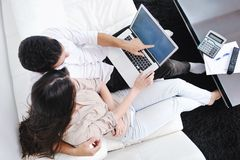 Couple relax and work on laptop computer at home Royalty Free Stock Photos