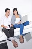 Couple relax and work on laptop computer at home Royalty Free Stock Photo