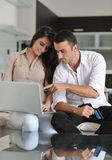 Couple relax and work on laptop computer at home Stock Image