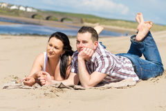 Couple at relaxation on the beach Royalty Free Stock Photos