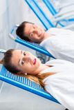 Couple in relaxation room of wellness spa stock photos