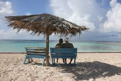 Couple relaxes on a beach on Anegada in the British Virgin Islands