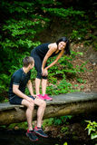 Couple relaxes after jogging Stock Photography